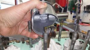 Piston mounting